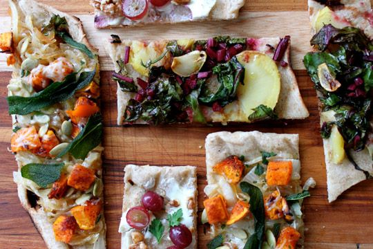 Three amazing flatbread recipes: Pumpkin, Caramelized Onion and Sage Flatbread; Beet Green, Potato and Garlic Oil Flatbread (vegan); and Grape, Goat Cheese and Walnut Flatbread