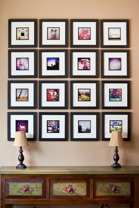 love the uniformity with black frames but I would put postcards or photos inside from my world travels
