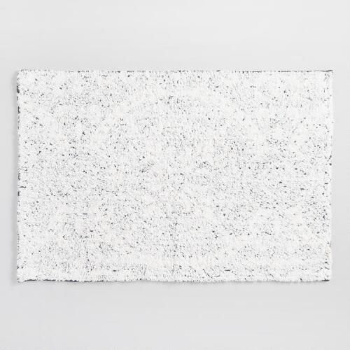 White tufted yarn is woven on top of a printed medallion pattern in our exclusive bath mat for a subtle abstract effect that makes it a good match for nautical, ocean-inspired or farmhouse decor.