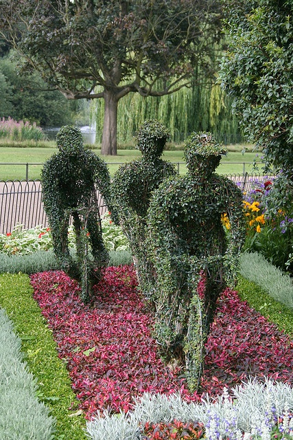 Three topiary cyclists, St James's Park, London