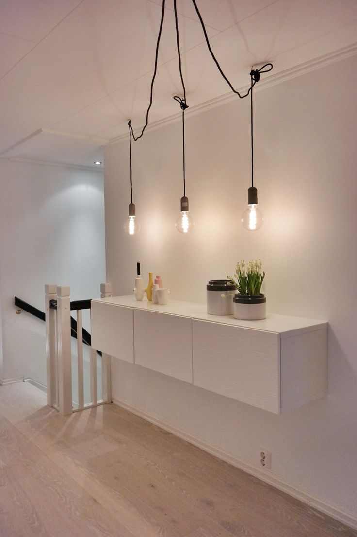 My hallway. Concrete lamps from Nud Collection. Fiducia vase from Kahler. Muscari in jars from Kremmerhuset. Ikea bestå.