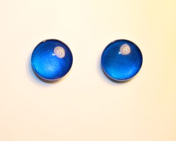 Handmade Disco Blue cabochon stud earrings. Approximate size 8mm. Hypo-allergenic stainless steel post and butterfly backs.     Note: Handmade items may vary in size and colour from one piece to another. Please do not immerse in water or clean with chemical cleaners. Colour of item may vary dependent on computer/hand held device screen.