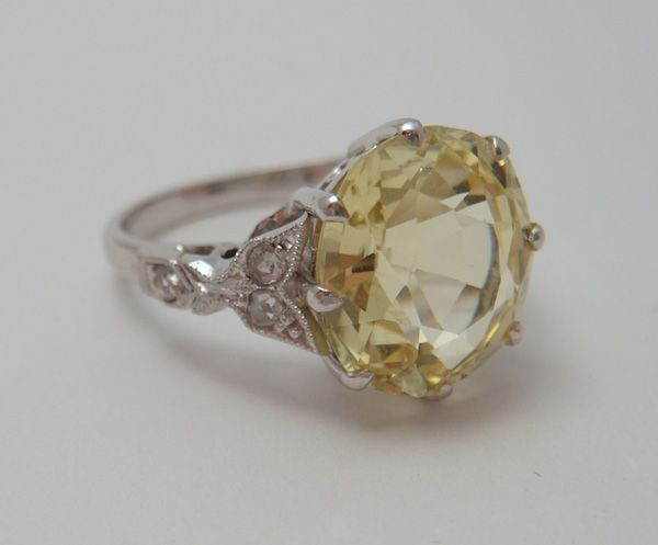 LOVE LOVE LOVE This is a yellow sapphire, but I have one very similar that is citrine for two of my kids birthstones.