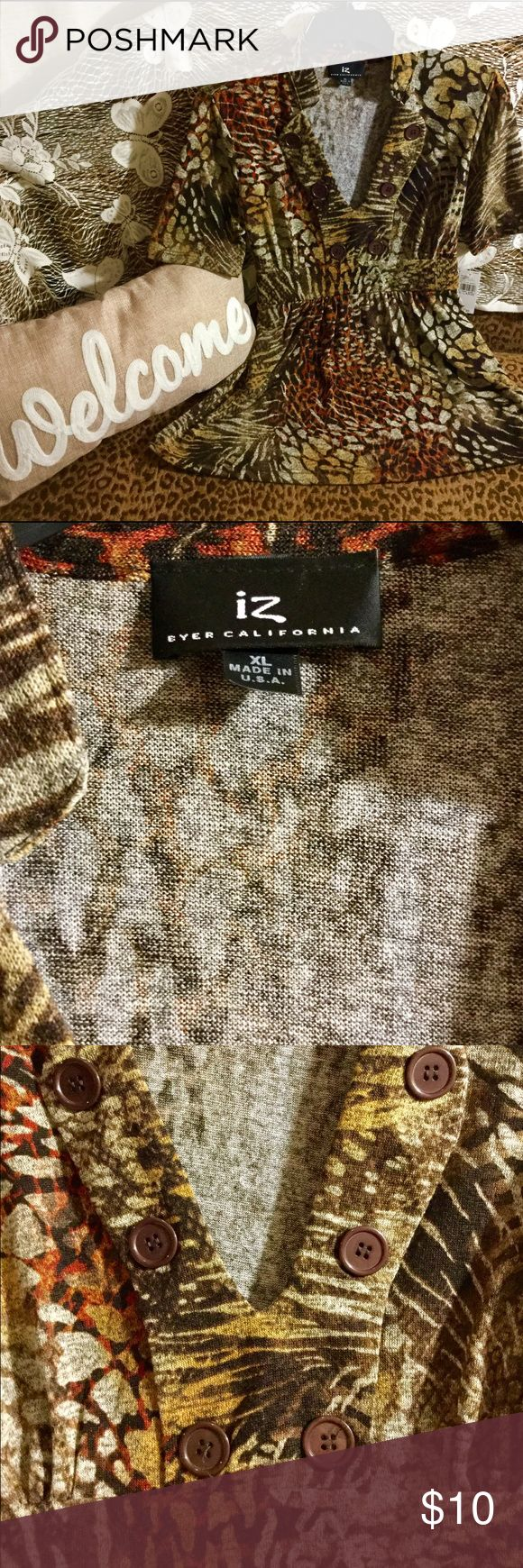 IZ Women's Top! IZ Women's Top! Beautiful short sleeve banded collar multi colored Safari print top. Adorable necklace with brown buttons on each side. Top ties in back to adjust for comfort. BNWT! Size XL IZ Tops
