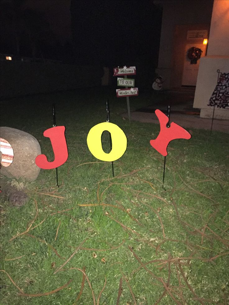 """Cut the letters out of 1/4"""" plywood; added some hooks and hung them on Shepard hooks."""