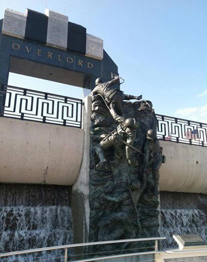"""One of the defining pieces at the Memorial is the """"Overlord Arch"""" that stands 44 ft. and 6 in. high signifying the date of D-Day - June 6, 1944. So much of the Memorial is symbolic with many artistic elements including bronze sculptures, and an invasion tableau with the sounds and sprays of bullets hitting the water just as it happened during the invasion. There is so much more to experience at the Memorial as it steps you through the invasion from planning stages through the end of the war…"""