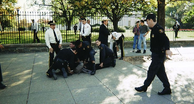 Secret Service agents wrestle with Francisco Martin Duran in front of the White House, Saturday, Oct. 29, 1994, in Washington, D.C., after emptying the magazine on his Chinese SKS semi-automatic rifle at the White House by AP Photo/Felix Castillo, Jr.