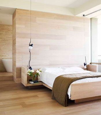 Bright wood for bed and wall - integrated bathroom - like this style