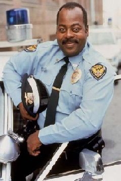 """This picture is of Carl Winslow(Reginald VelJohnson) from """"Family Matters"""". He is a typical sitcom bumbling loveable idiot of a father. He isn't the most idiotic person on the show, but he is often shown up by resident """"nerd""""  Steve Urkel. Carl has a job as a local police officer. He seems to love what he does, but he doesn't seem to be the greatest officer. (observation)"""