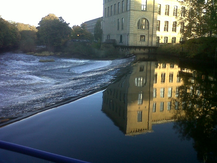 The River Aire at Salt's Mill , Saltaire, West Yorkshire.