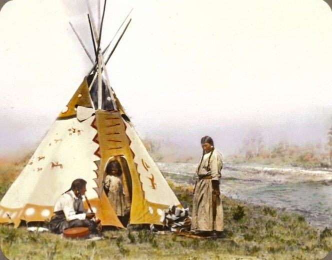 This photograph features Onetsa, Nitana, and their daughter Yellow Mink, part of the Siksika nation in southern Alberta, Canada, around the early 1900s.