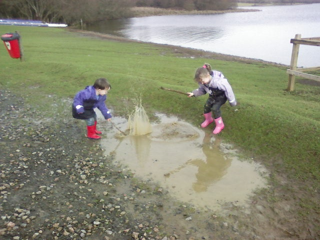 """""""Here is a photo of our 2 kids (Sophie and Ollie) enjoying a traditional summer day!  The photo was taken a couple of years ago now at Roadford Lake on the Devon/Cornwall border. They had come to watch me sailing on the lake, but had a lot more fun amusing themselves with the puddles. - They ARE a Peppa & George (if you watch Peppa pig!)"""" - Photo by Andi Wyer"""