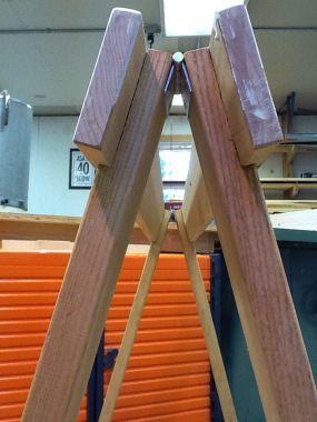 Folding sawhorse stows away