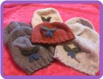 """On Sale For The Holidays: One of A Kind Haskap Applique' Hand Knitted Wool Hat The hats are hand knitted from ethically produced Natural, Unbleached Washable Warm, Water-Resistant, Prickle-Free Canadian Wool. The """"Haskap Berry"""" applique is made from felted wool and embroidery."""