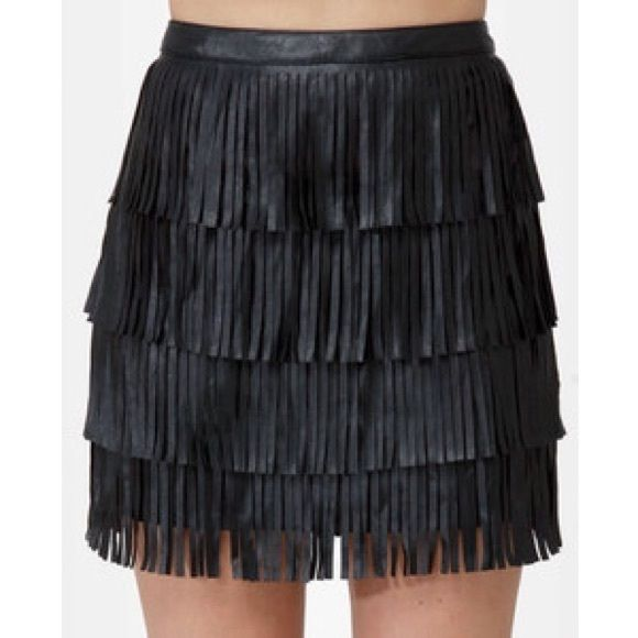 Black leather mini skirt w/ fringe Black leather mini skirt with fringe, only worn once! Skirts Mini