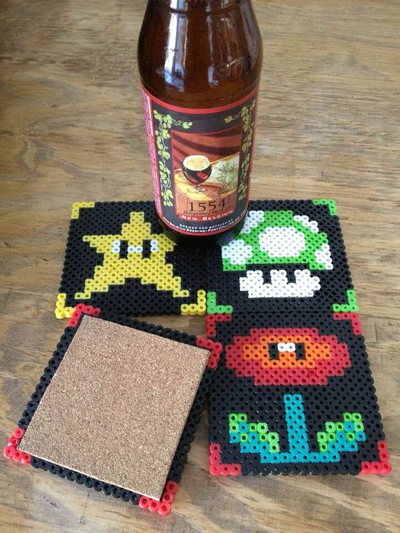 Super Mario Brothers Coasters - Use those iron-together craft beads to make the patterns, than iron them solid, cut some thin cork board for the backing and gently super glue/hot glue to the back of each design :)