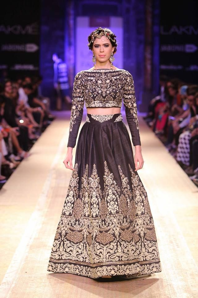 Black long sleeved crop top blouse with high waisted Indian lehnga by Anju Modi at Lakme Fashion Week Winter 2014. More here: http://www.indianweddingsite.com/lakme-fashion-week-winter-2014-anju-modi-collection/