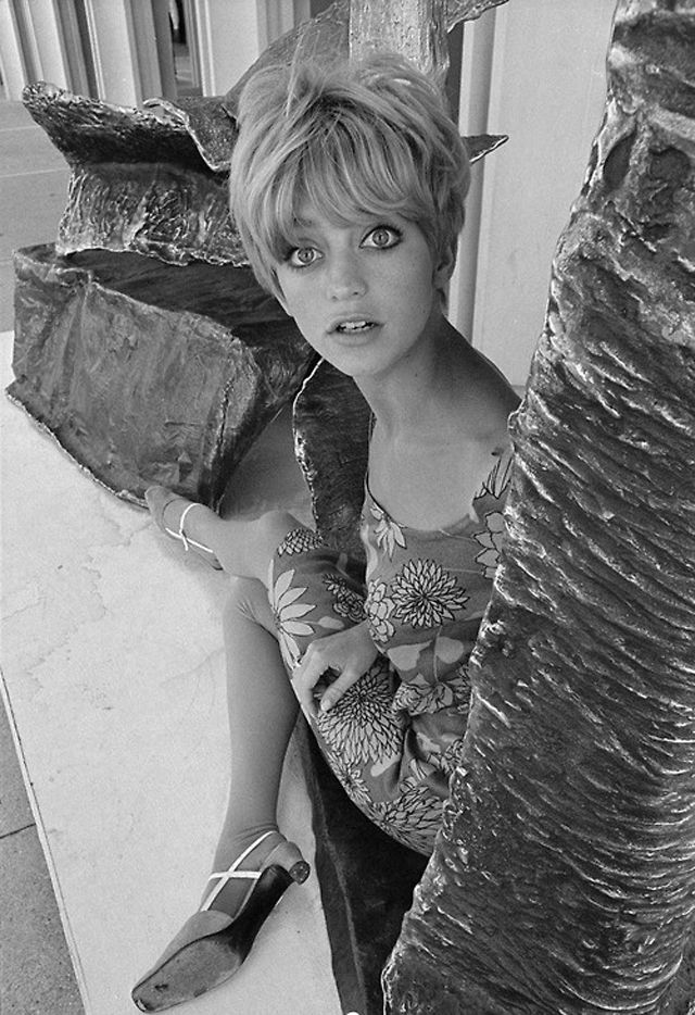 "Actress Goldie Hawn was also seen as a 1960s ""It"" girl, equipped with the quintessential haircut and doe eyes. She gained fame on the hit TV series, Laugh In, but quickly moved from TV to movies. Her career has only blossomed since then, but we love old-school Goldie style."