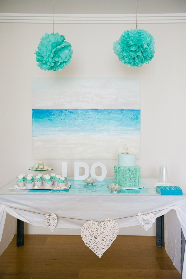 A cute and simple beach themed dessert table.