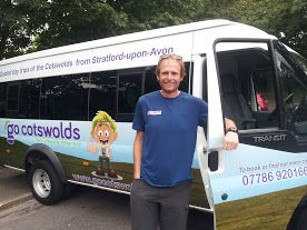 Go Cotswolds' driver and guide, Tom, standing by the Go Cotswolds minibus www.gocotswolds.co.uk
