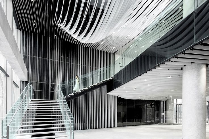Hongkou Soho by Kengo Kuma:  Louvers made of thin, flexible sheet aluminum, powder-coated white, undulate across the ceiling and down a wall.