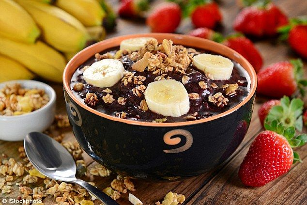 Brazil: This is a typical Brazilian berry fruit bowl using #acai berries, topped with banan...