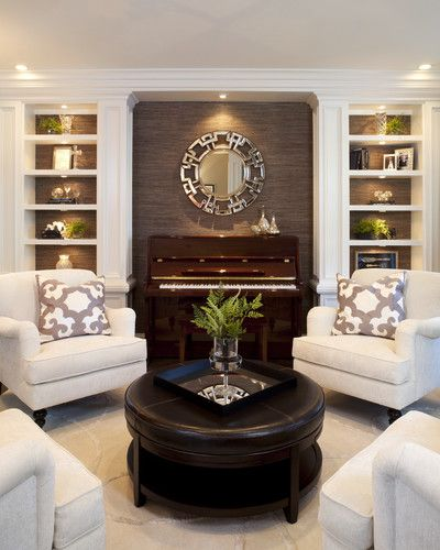 Like the color combo-Living room with taupe accent wall, white built ins,