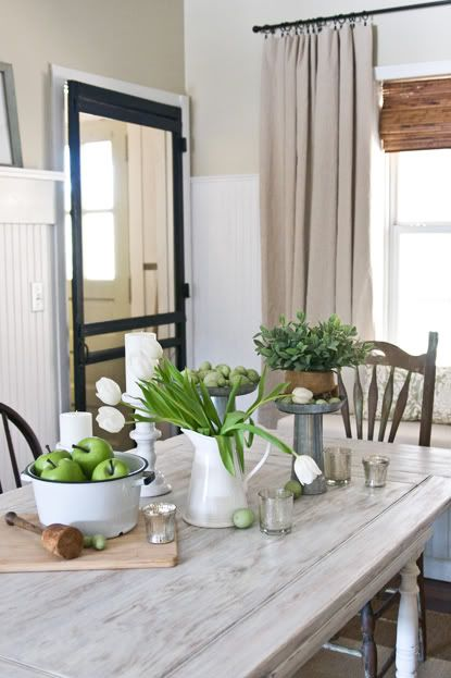 I love this dinning table and display. Look at the screen door in the background!