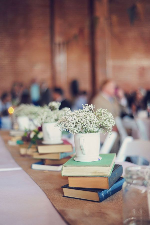 """love the idea of doing a stack of vintage books, a mug (maybe even with our initial on it?) and baby's breath for the centerpieces! Simple, inexpensive, and very """"us."""" we love books and coffee/tea."""