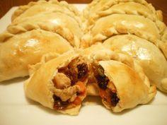 chicken empanada : * chicken breast * onion * garlic * potato * carrot * green peas * raisins * salt * black pepper * sugar * oil
