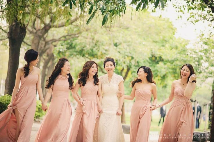 Nothing looks more feminine and romantic than blush bridesmaid gowns!