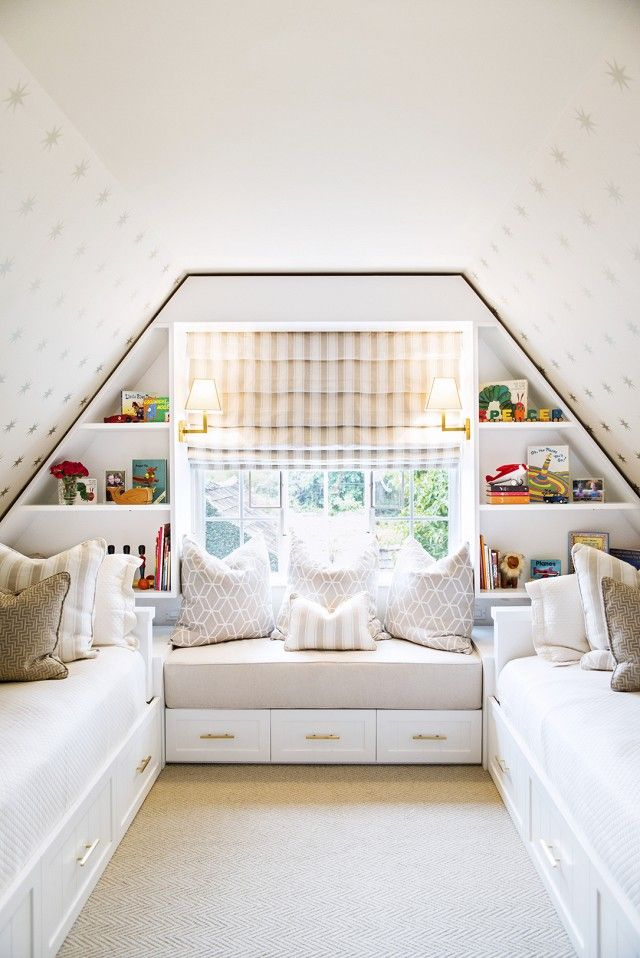 Bright attic bedroom with built-in shelves