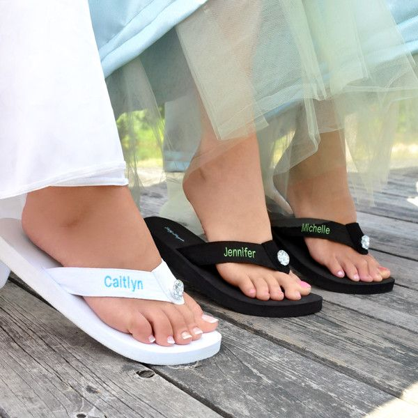 Fashioned with a grosgrain foot strap and foam rubber heel for comfort, the Personalized Flips Flops are accented with a center rhinestone and customized name and thread color on both flip flops. Avai