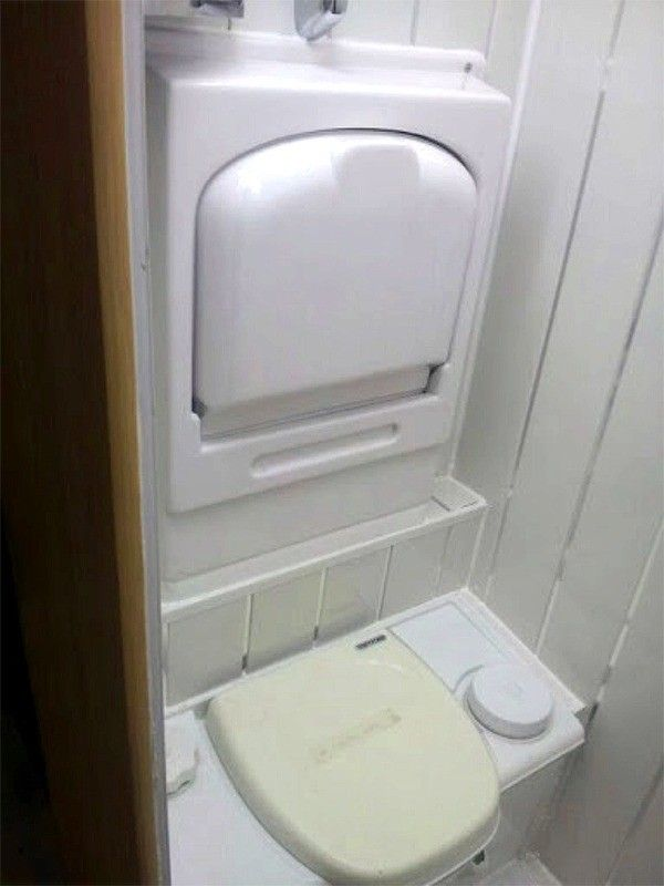Toilet With Fold Up Sink Above For Efficient Use Of Space
