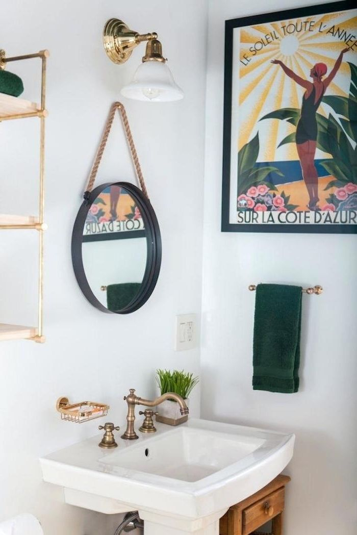 Vintage Brass Faucet On A White Sink In A Room With White Walls