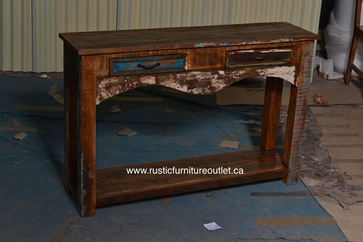 """Crafted from recycled wood solids in a multi-colored hand-painted finish ensuring bonafide originality, this console table or sofa table offers the faded colors of an heirloom as well as an alluring rustic charm.  http://www.rusticfurnitureoutlet.ca/recycledwoodfurn.html  Dimensions: 45""""L x 30""""H x 12"""" D  Cost: 299$"""