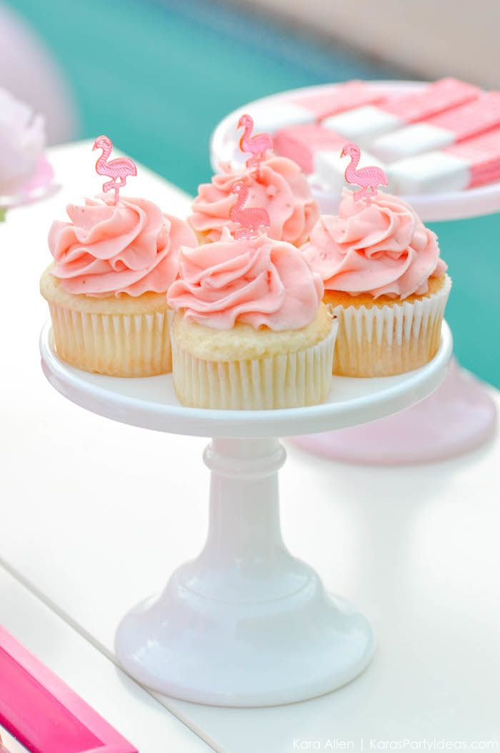Flamingo cupcakes at a pink flamingo Pool + Art Birthday Party by Kara Allen