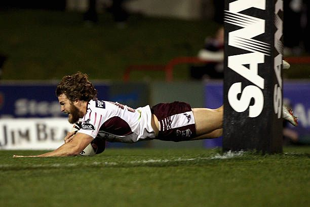 David Williams of the Sea Eagles dives to score a try during the round 26 NRL match between the Penrith Panthers and the Manly Warringah Sea Eagles...