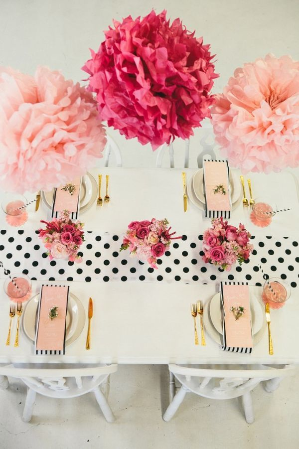 Once Valentine's Day approaches, it's a sweet excuse to go with a girly palette of pinks and reds. While you could certainly use peonies and roses in this shade, a more cost-friendly tactic is to use tissue paper poms. | Best Ideas for a Winter Bridal Shower