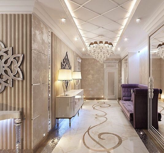 Very high end luxurious hallway with a motif on the floor, purple velvet settee, a white gloss console and a stunning chandelier. Everything is luxury, so it exudes opulence. Luxury Beauty - http://amzn.to/2jx73RT