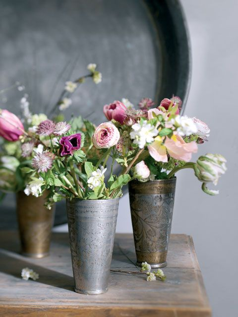 Traditional wedding cups filled with flowers       Happinez Magazine