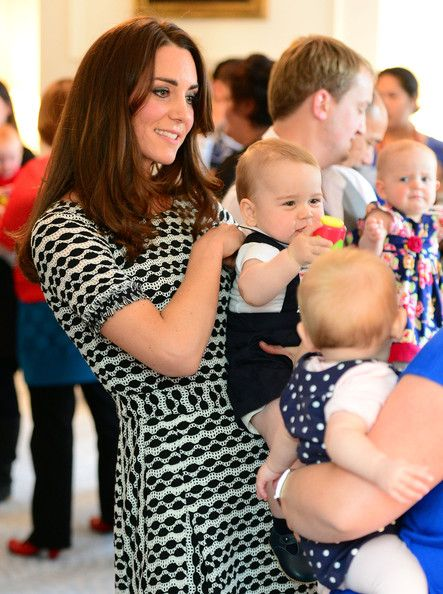 9 April 2014 - The Duchess of Cambridge mingled with the other first-time parents, proudly introducing her son to the children