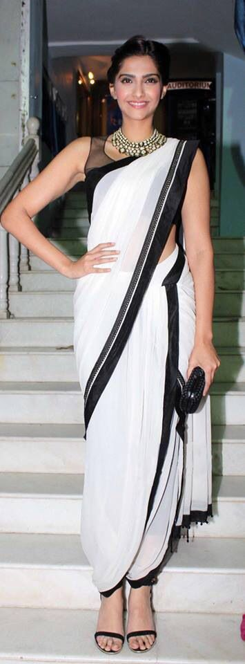Love the way she is carrying her dhoti saree