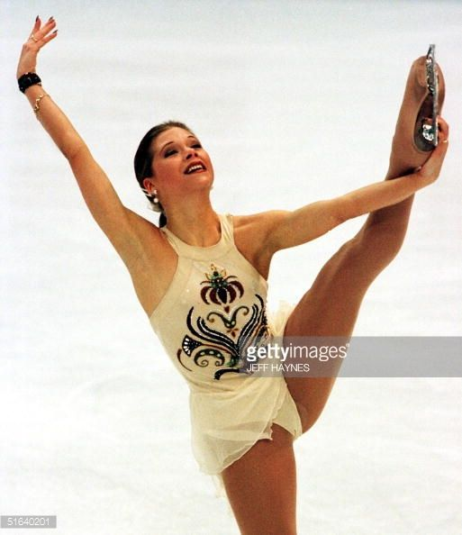 MINNEAPOLIS, UNITED STATES: Tanja Szewczenko of Germany finishes her program after crashing into the boards around the ice during the ladies short program 03 April at World Figure Skating Championships at the Target Center in Minneapolis, MN. This is the second time bad luck has plagued her after having to pull out of the olympics because of the flu. AFP PHOTO/Jeff HAYNES (Photo credit should read JEFF HAYNES/AFP/Getty Images)