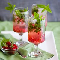 Strawberry Mojito Cocktail | Strawberry Mojito Recipe    1.5 ounces of simple syrup  about 3 fresh strawberries  about 4-5 fresh spearmint sprigs (chopped if you prefer smaller mint pieces in your cocktail)  soda water  1/2 lime  2 ounces of light rum