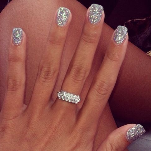 Glittery nails and tan skin