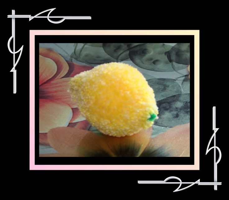 Sculptured Yarn (pompoms) lemon. Available for purchase at thatissocool.ca