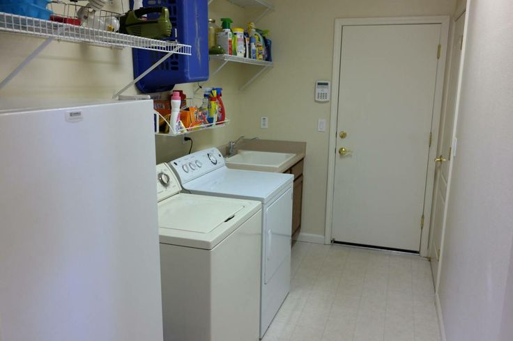 Extra Large Utility Sink : The large laundry room has a utility sink and a huge closet for extra ...
