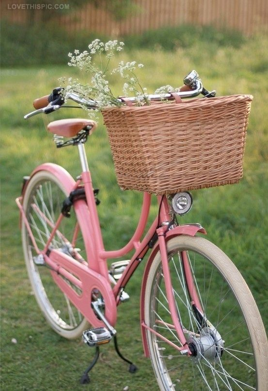Vintage pink bike with basket - can't you just see yourself whizzing along on this?  Nice pink floral dress and hair blowing in the wind?