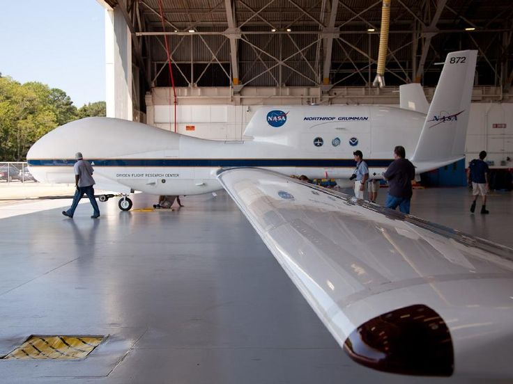 NASA - Global Hawk Aircraft: This image captures a perspective of NASA's Global Hawk unmanned aircraft from one of the wings. The Global Hawk is sitting at the aircraft hangar of NASA's Wallops Flight Facility in Wallops Island, Va. on Sept. 7, 2012. The month-long Hurricane and Severe Storm Sentinel (HS3), which began in early September, is currently deploying one instrument-laden Global Hawk from the NASA Wallops Flight Facility to look at the environment of tropical storms.